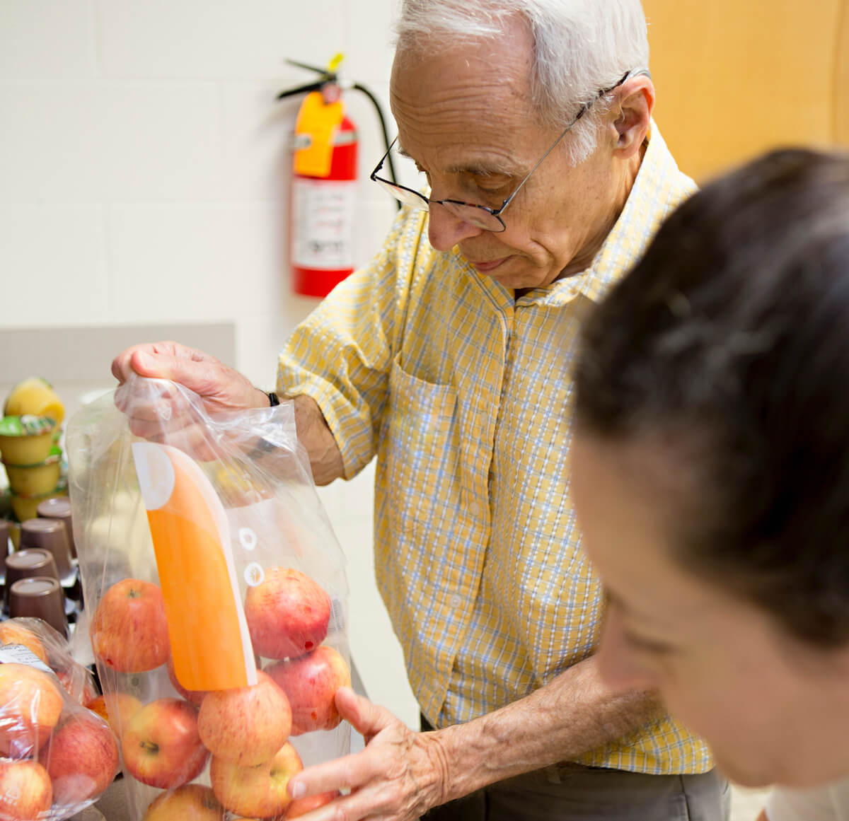A resident at Carolina Meadows helping out with a community food