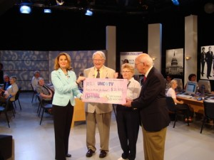 Shannon Vickery, left, receives Carolina Meadows' check from residents Don Stedman, Helen Stedman and Roy Carroll as residents and staff look on.