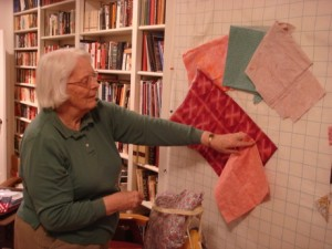 Anne Jones designs a new quilt by arranging fabric swatches. Photo: Jim Borden
