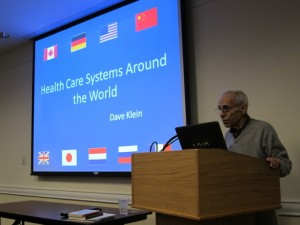 Dr. David Klein speaks on health care systems around the world. Photo: Joe Mengel