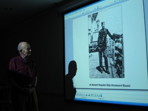 Carolina Meadows resident Lovick Miller discusses his time as a POW during a presentation in the Fairways Gallery.
