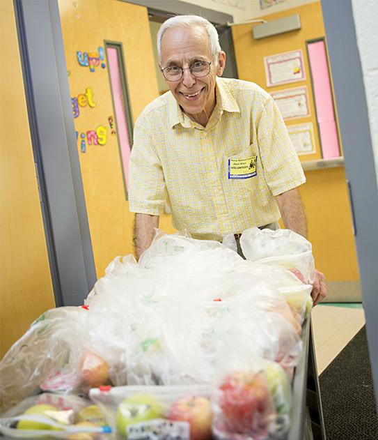 Carolina Meadows resident volunteering at a school