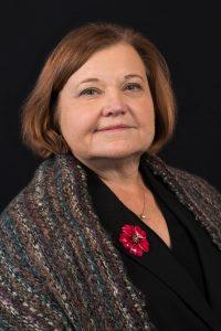 A headshot of Joan C. Pharr