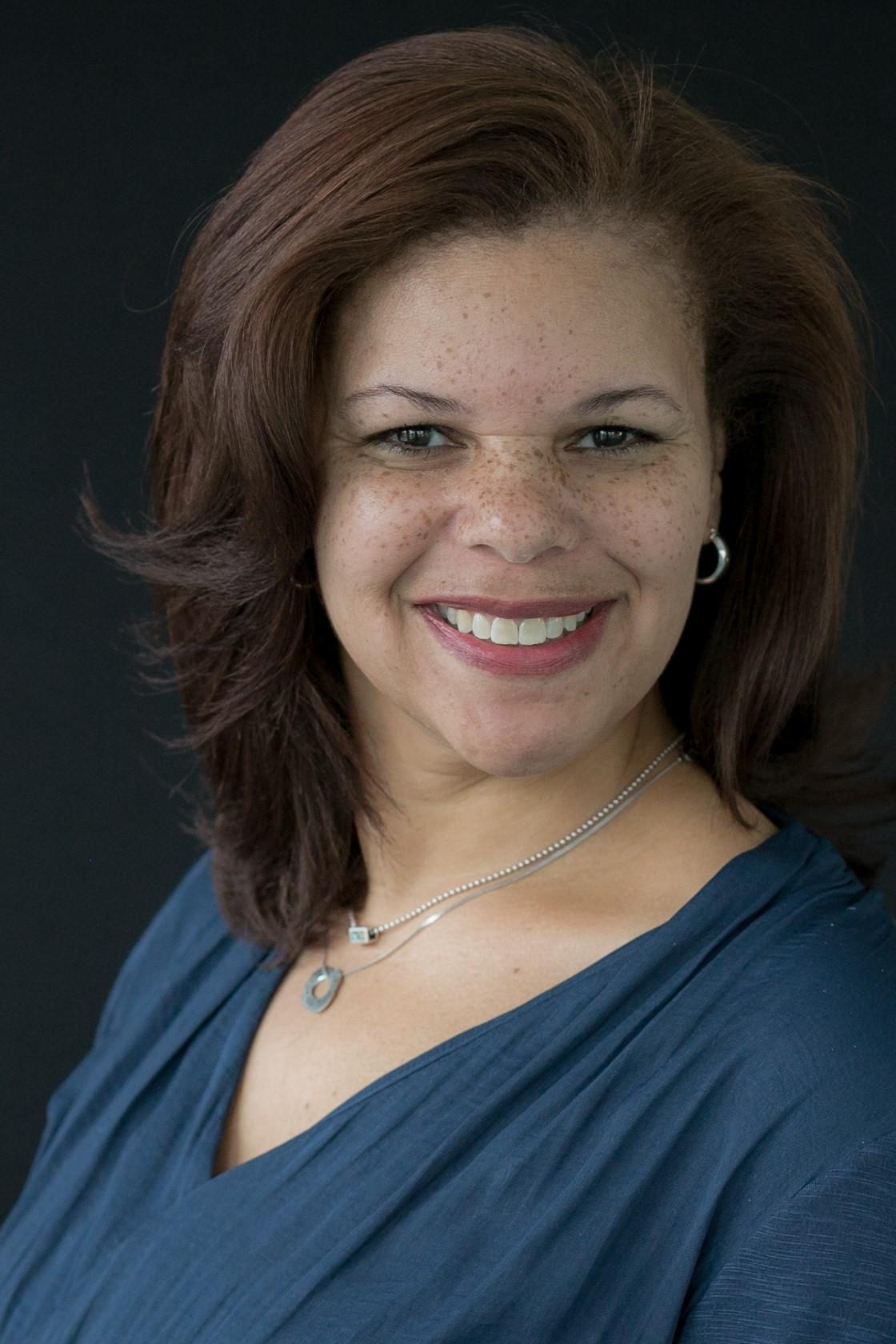 A headshot of Adele Dowell