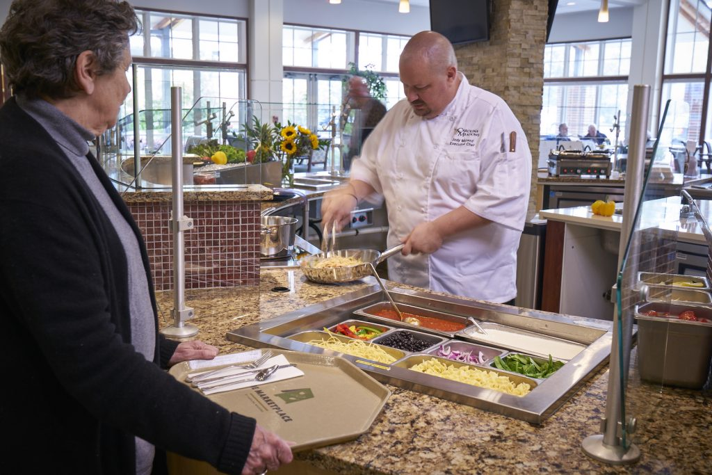 Chef Jody preparing a meal for a resident at Carolina Meadows