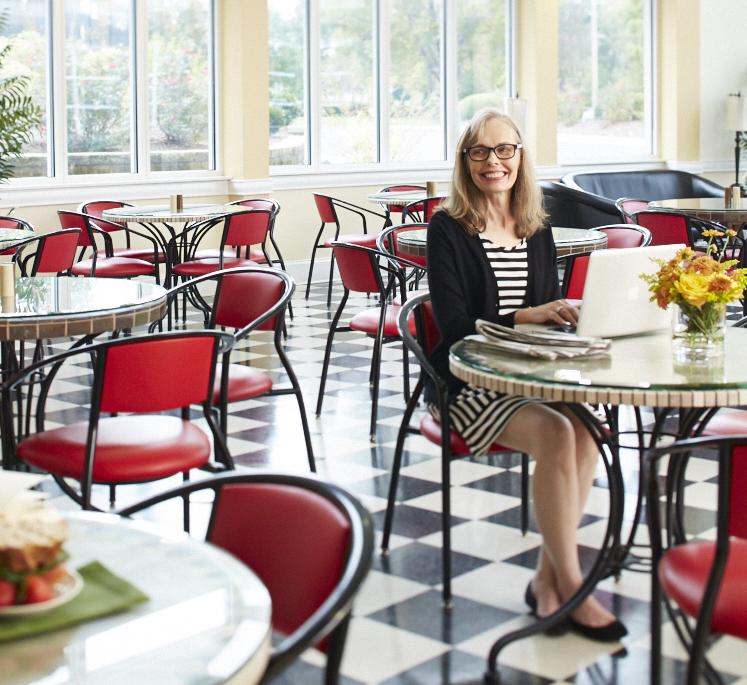 Resident enjoying The Café at Carolina Meadows